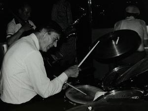 Drummer Jack Parnell Playing at the Middlesex and Herts Country Club, Harrow Weald, London, 1981 by Denis Williams
