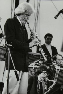 Gerry Mulligan Playing at the Capital Radio Jazz Festival, Knebworth, Hertfordshire, July 1982 by Denis Williams