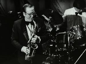 Harry Bence Playing the Saxophone at the Forum Theatre, Hatfield, Hertfordshire, 1984 by Denis Williams
