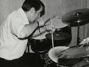 Kenny Clare Playing the Drums, London, 1978 by Denis Williams