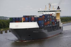 A Containers Ship Travels the Kiel Canal, Germany by Dennis Brack