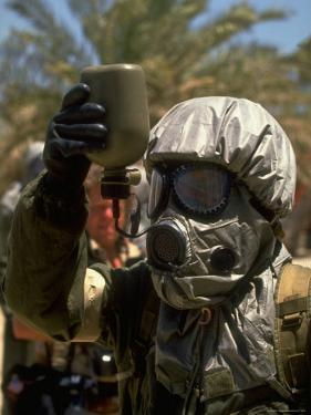 Soldier Wears Protective Outfit and Gas Mask Against Possible Gulf Iraqi Biological Weapon Attack by Dennis Brack