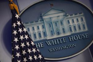 The Flag and Seal at a White House Press Briefing by Dennis Brack