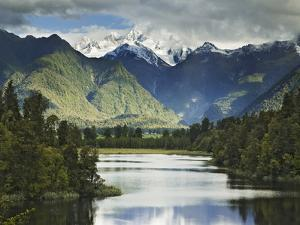 Cloud-Shrouded Mt. Cook Reflected in Lake Matheson, Near Town of Fox Glacier, South Island by Dennis Flaherty