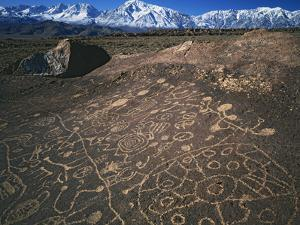 Curvilinear Abstract-Style Petroglyphs and Eastern Sierra Mountains, Bishop, California, Usa by Dennis Flaherty