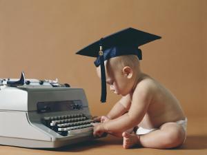 Baby Wearing Graduation Cap Typing on Typewriter by Dennis Hallinan