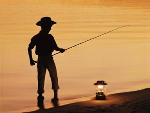 Boy Pole Fishing by Shoreline with an Oil Lamp by Dennis Hallinan