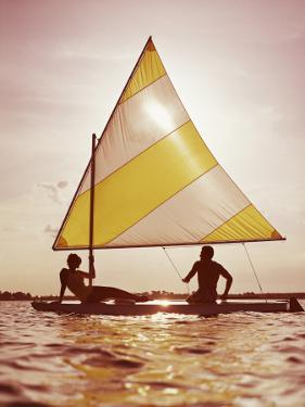 Couple Sailing on Small Boat by Dennis Hallinan