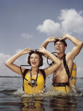 Couple Scuba Diving by Dennis Hallinan