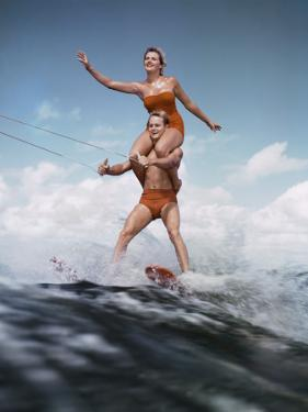 Couple Waterskiing Together by Dennis Hallinan
