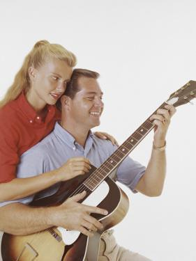 Couple with Guitar by Dennis Hallinan