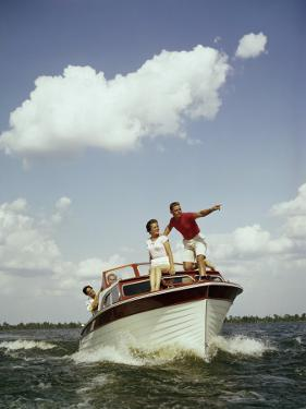 Couples Enjoy Speed Boat Ride by Dennis Hallinan