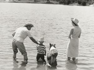 Family Fishing by Lake by Dennis Hallinan