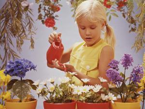 Girl Watering Flowers by Dennis Hallinan