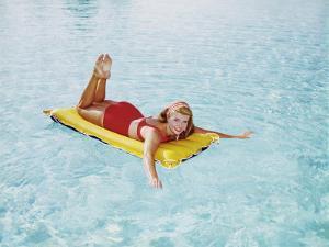 Happy Woman Sun on Bathing Inflatable Pool Raft by Dennis Hallinan