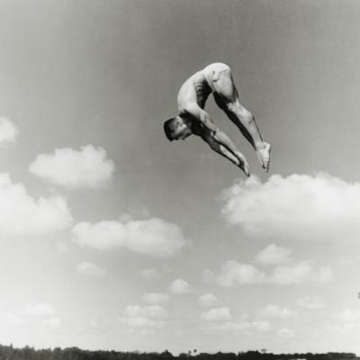 Man Jumping Off Diving Board by Dennis Hallinan