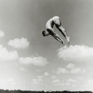 Man Jumping Off Diving Board by Dennis Hallinan