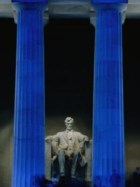 Abraham Lincoln Statue Between Blue Floodlit Columns of Lincoln Memorial, Washington Dc, USA by Dennis Johnson