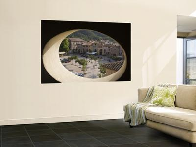 Town Square and Nearby Hills Through Oval Hotel Window by Dennis Johnson