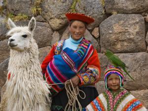 Woman with Llama, Boy, and Parrot, Sacsayhuaman Inca Ruins, Cusco, Peru by Dennis Kirkland