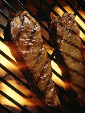 Steaks Cooking on Grill by Dennis Lane