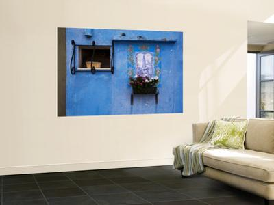 Blue Wall with Window and Religious Painting