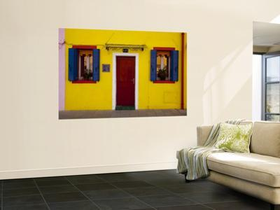 Colorful Windows and Door on Yellow House