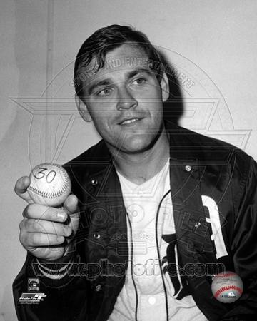 Denny McLain holds the baseball after his 30th win of the season, September 14, 1968