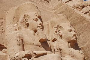 Statues of Pharaoh Ramesses II decorating facade of temple, The Great Temple, Abu Simbel, Nubia by Derek Hall