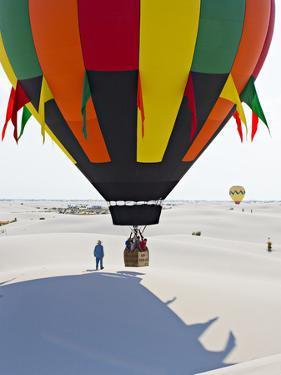 A Basket Load of People on a Hot Air Balloon Prepares to Ascend by Derek Von Briesen