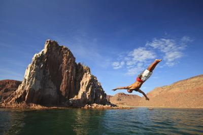 A Man Dives into the Water Off Espiritu Santos Island Near La Paz; Baja California Mexico by Design Pics Inc