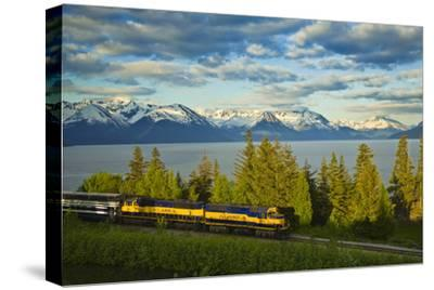 Alaska Railroad Passes in Front of Turnagain Arm Near Bird Point Heading Towards Anchorage by Design Pics Inc