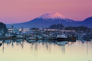 Alpenglow Sunrise on Mt. Edgecumbe and the Small Boat Harbor in Sitka, Alaska by Design Pics Inc