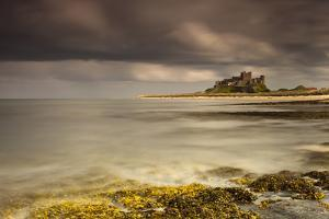 Bamburgh Castle under a Cloudy Sky; Bamburgh Northumberland England by Design Pics Inc