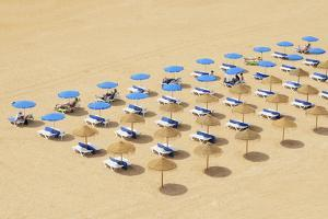 Beach Chairs and Umbrellas Set Up in Row on the Beach; Albufeira Algarve Portugal by Design Pics Inc