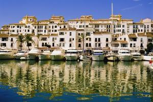 Boats and Houses on Waterfront by Design Pics Inc