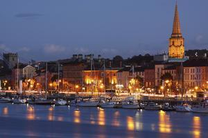 Boats Moored on River Suir at City Waterfront at Night; Waterford City, County Waterford, Ireland by Design Pics Inc