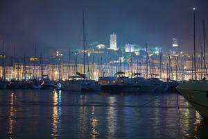 Cannes, Provence, France; Buildings Illuminated on Shore and the Harbor at Night by Design Pics Inc
