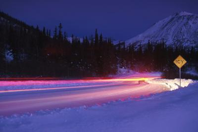 Car on Icy Road Evening Winter Southcentral Ak by Design Pics Inc