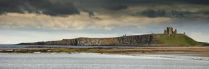 Dunstanburgh Castle on a Hill under a Cloudy Sky; Bamburgh Northumberland England by Design Pics Inc