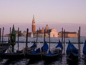 Gondolas on Canal, Church of St. Giorgio Maggiore in Background; Grand Canal, Venice, Italy by Design Pics Inc