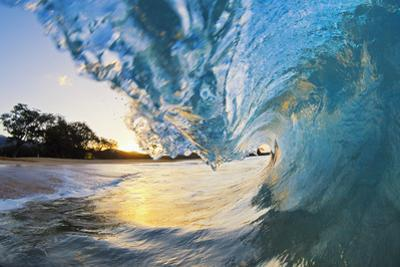 Hawaii, Maui, Makena, Beautiful Blue Ocean Wave Breaking at the Beach at Sunrise by Design Pics Inc
