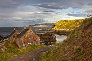 Houses at the Water's Edge and a Mooring Boat; Cove Lothian Scotland by Design Pics Inc