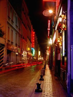 Illuminated Street at Night by Design Pics Inc
