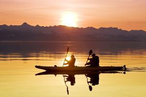 Kayakers Paddle the Calm Waters of Alaska's Lynn Canal at Sunset with the Chilkat Mountains by Design Pics Inc