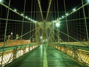 Looking Along Walkway on the Brooklyn Bridge at Night by Design Pics Inc