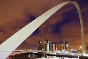 Looking over the Tyne at Dusk Through the Winking Bridge to the Baltic Arts Centre by Design Pics Inc