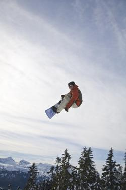 Man Snowboarding, Jumping in Mid-Air; Vancouver Island Ranges, British Columbia, Canada by Design Pics Inc