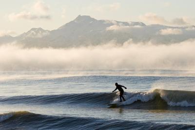 Man Surfing in Moring Near Homer Kachemak Bay with Kenai Mountains Kenai Peninsula Alaska Winter by Design Pics Inc