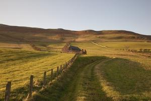Northumberland, England; a Farm Structure and a Fence around a Field by Design Pics Inc